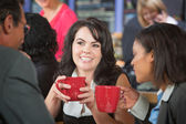 Grinning Woman with Coffee and Coworkers — Stock Photo