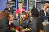 Shocked Woman in Cafe — Stock Photo
