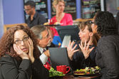 Bored Woman with Co-Workers in Cafe — Stock Photo