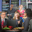 Business People Talking in Cafe — Stock Photo #42918285
