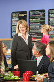 Business People in Cafe Talking — Stock Photo