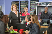Happy Bistro Owner with Customers — Stock Photo