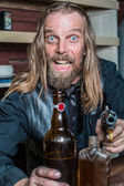Crazed Western Man at Table — Stock Photo
