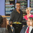 Serving Customers Food — Stock Photo