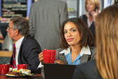 Woman Listening to Coworker — Stock Photo