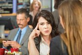 Woman with Finger on Head — Stock Photo