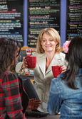 Woman Serving Drinks — Stock Photo