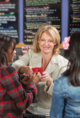 Cashier Serving Drinks — Stock Photo