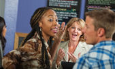 Cafe Owner with Irritated Customers — Stock Photo
