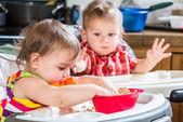 Two Babies Eat Breakfast — Stock Photo