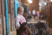 Girl with miniature horse at state fair — Stock Photo