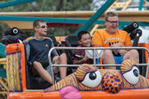 Boys on carnival ride at state fair — Stock Photo