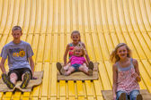 Kids on carnival slide at state fair — Photo