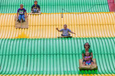 People on carnival slide at state fair — Photo
