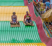 People on carnival slide at state fair — Stock Photo