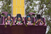 Girls on carnival ride at state fair — Stock Photo