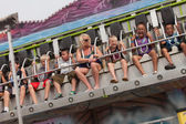 People on carnival ride at state fair — Stock Photo