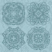 Set of four lace decorative ornaments — Stock Vector