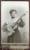 Vintage photo of young woman with guitar. — Stock Photo