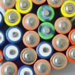 Stock Photo: Concept background of batteries AA