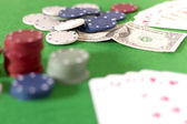 Poker game, chips and cards on green baize — Stock Photo