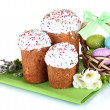 Beautiful Easter cakes, colorful eggs in basket and flowers isolated on white — Stock Photo #10347321