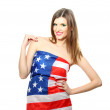 Beautiful young woman wrapped in American flag isolated on white — Stock Photo #10496430