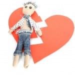 Voodoo doll boy on the broken heart isolated on white — Stock Photo #10940874