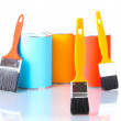 Cans of paint with paintbrushes isolated on white close-up — Stock Photo #11453801