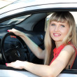 Happy smiling blonde woman in car — Stock Photo #11459918