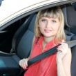 Happy smiling blonde woman in car — Stock Photo #11473250
