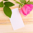 Beautiful rose on wooden background — Stock Photo