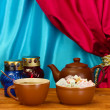 图库照片: Teapot with cup and saucer with sweet turkish delight on wooden table on a