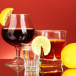 Variety of alcoholic drinks on red background — Stock Photo #12567323