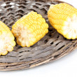 Stock Photo: Fresh corn on wicker mat isolated on white