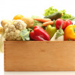 Fresh vegetables in wooden box isolated on white — Stock Photo #12567698