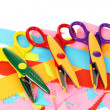 Colorful zigzag scissors with color paper isolated on white — Stock Photo #12568140