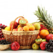 Assortment of exotic fruits and berries in baskets isolated on white — Stock Photo #12568203