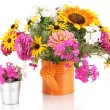 Beautiful bouquet of bright flowers in bailer isolated on white — Stock Photo