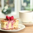 Sweet cake with cup of tea on wooden table — Stock Photo #12569307