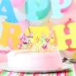 Sweet birthday with candles cake on plate — Stock Photo #12569577