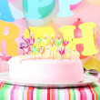 Sweet birthday with candles cake on plate - Stock Photo
