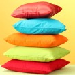 Colorful pillows on yellow background — Stock Photo #12569692