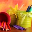 Colorful pencils and felt-tip pens in pails on color background — Stok fotoğraf
