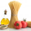Pasta spaghetti, tomatoes and oil, isolated on white — Stock Photo #12569970