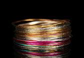 Beautiful bracelet isolated on black background — Stock Photo