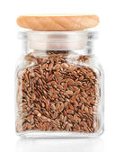 Flax seeds in glass jar isolated on white — Stock Photo