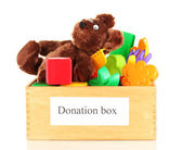 Donation box with children toys isolated on white — Stok fotoğraf