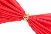 Röd duk knuten med pärlor isolerade på vit — Stockfoto