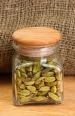 Jar of green cardamom on canvas background close-up — Stock Photo